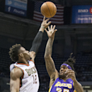 Milwaukee Bucks' Jeff Adrien blocks the shot of Los Angeles Lakers' Jordan Hill during the first half of an NBA basketball game Thursday, March 27, 2014, in Milwaukee The Associated Press