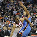 Milwaukee Bucks' Gary Neal (12) drives around the Oklahoma City Thunder's Derek Fisher during the second half of an NBA basketball game Saturday, Nov. 16, 2013, in Milwaukee. The Thunder defeated the Bucks 92-79 The Associated Press