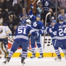 Toronto Maple Leafs' James van Riemsdyk, center, celebrates after scoring his team's opening goal against Buffalo Sabres during the first period of an NHL hockey game, Saturday, Nov. 16, 2013 The Associated Press