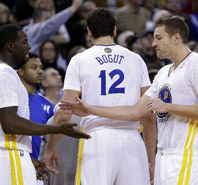 Golden State Warriors' Draymond Green, left, is congratulated by David Lee (10) after Green was ejected from an NBA basketball game against the Portland Trail Blazers Saturday, Nov. 23, 2013, in Oakland, Calif