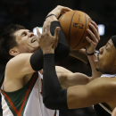 Brooklyn Nets' Paul Pierce, right, defends against Milwaukee Bucks' Ersan Ilyasova, left, in the second half of an NBA basketball game Saturday, March 1, 2014, in Milwaukee The Associated Press