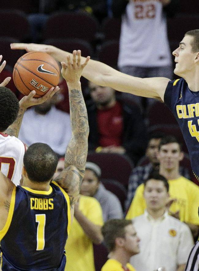 Southern California's J.T. Terrell, left, gets his shot blocked by California's David Kravish during the first half of an NCAA college basketball game on Wednesday, Jan. 22, 2014, in Los Angeles