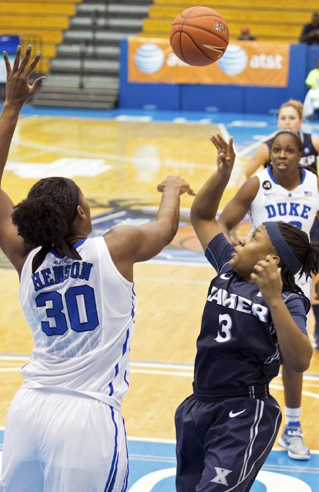 Duke forward Amber Henson, left, blocks a shot by Xavier guard Shatyra Hawkes during the first half of an NCAA college basketball game in St. Thomas, U.S. Virgin Islands, Thursday, Nov. 28, 2013