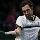 Kazakhstan's Mikhail Kukushkin returns a shot to Croatia's Marin Cilic during their semifinal match at the Kremlin Cup tennis tournament in Moscow, Russia, Saturday, Oct. 18, 2014. (AP Photo/Ivan Sekretarev)