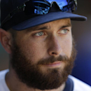 This Aug. 11, 2013 photo shows Seattle Mariners' Dustin Ackley in the dugout during a post-game interview in Seattle. The Mariners are hoping Ackley is back to the hitter he was coming out of college and early in his Seattle career, and less like the unce