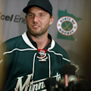 In this July 1, 2014 file photo, Thomas Vanek poses after he signed a three-year deal to play with the Minnesota Wild NHL hockey team in St. Paul, Minn. Vanek says he's cooperating with federal authorities conducting an investigation in Rochester, N.Y. L