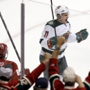 As Minnesota Wild fans cheer, Wild's Zach Parise celebrates his empty-net goal against the Phoenix Coyotes during the third period of an NHL hockey game, Saturday, March 29, 2014, in Glendale, Ariz. The Wild defeated the Coyotes 3-1 The Associated Press