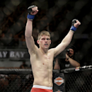 Stephen Thompson celebrates his TKO win over Robert Whittaker following a UFC 170 mixed martial arts welterweight fight on Saturday, Feb. 22, 2014, in Las Vegas. (AP Photo/Isaac Brekken)