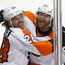Philadelphia Flyers' Claude Giroux (28) celebrates his goal with teammate Jakub Voracek (93) in the third period of an NHL hockey game against the Pittsburgh Penguins in Pittsburgh, Saturday, April 12, 2014. The Flyers won in overtime, 4-3 The Associated
