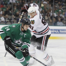 Dallas Stars forward Jamie Benn (14) battles Chicago Blackhawks forward Marian Hossa (81) for space in the first period of an NHL hockey game, Thursday, Oct. 9, 2014, in Dallas The Associated Press