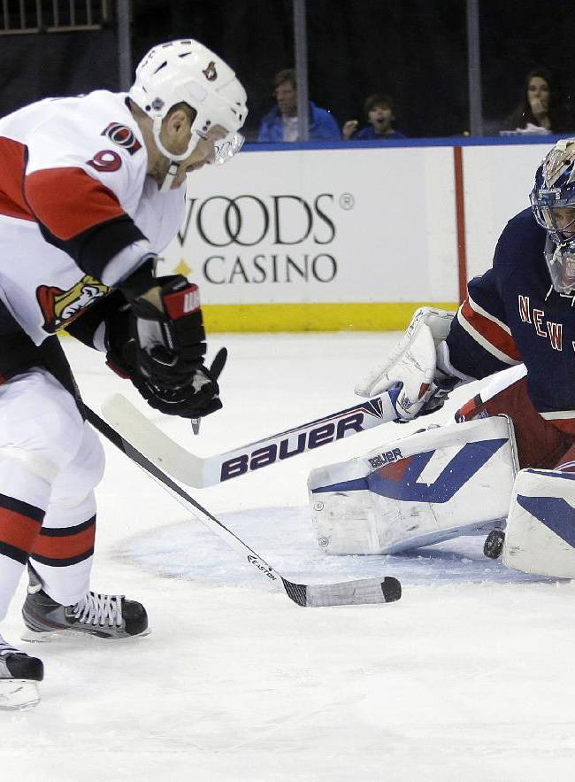 New York Rangers goalie Henrik Lundqvist (30), of Sweden, stops a shot by Ottawa Senators' Milan Michalek (9) during the first period of an NHL hockey game Saturday, April 5, 2014, in New York