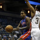 Detroit Pistons' Brandon Jennings, left, looks to pass around Milwaukee Bucks' John Henson (31) during the first half of an NBA basketball game on Wednesday, Dec. 4, 2013, in Milwaukee. (AP Photo/Morry Gash)