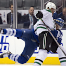 Toronto Maple Leafs left winger James van Riemsdyk, rear, and Dallas Stars defenseman Trevor Daley (6) tumble during the second period of an NHL hockey game, Thursday, Dec. 5, 2013 in Toronto The Associated Press