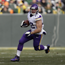 In this Nov. 24, 2013 file photo, Minnesota Vikings Toby Gerhart runs with the football during an NFL game against the Green Bay Packers at Lambeau Field in Green Bay Wis. The Jaguars contined its offensive makeover Tuesday night, March 11, 2014, by agre