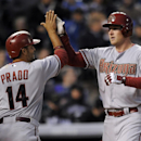 Arizona Diamondbacks Martin Prado, left, congratulates Mark Trumbo, right, after Trumbo hit a two-run home run in the third inning of a baseball game against the Colorado Rockies on Saturday, April 5, 2014, in Denver The Associated Press