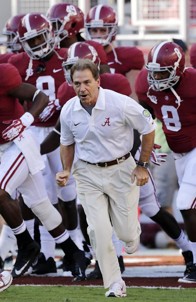 Alabama coach Nick Saban leads his team onto the field prior to an NCAA college football game against Mississippi in Tuscaloosa, Ala., Saturday, Sept. 28, 2013