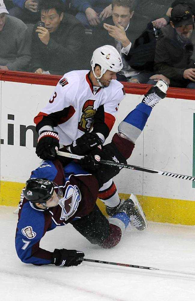 Colorado Avalanche center John Mitchell, bottom, and Ottawa Senators defenseman Marc Methot, top, collide in the first period of an NHL hockey game on Wednesday, Jan. 8, 2014, in Denver