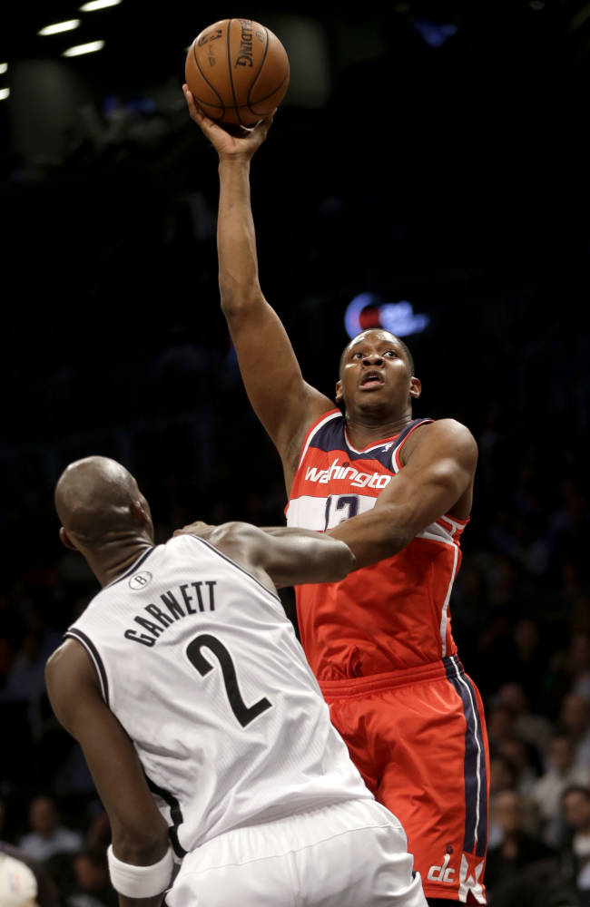 Wall scores 21, Wizards beat Nets 113-107