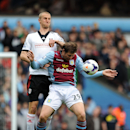 Aston Villa's Grant Holt, right, and Fulham's Brede Hangeland battle for the ball during their English Premier League soccer match at Villa Park, Birmingham, England, Saturday, April 5, 2014