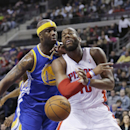 Detroit Pistons forward Greg Monroe (10) is fouled by Golden State Warriors center Jermaine O'Neal (7) during the first half of an NBA basketball game in Auburn Hills, Mich., Monday, Feb. 24, 2014 The Associated Press