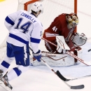 Phoenix Coyotes' Mike Smith (41) makes a save on a shot as Tampa Bay Lightning's Brett Connolly (14) looks for a rebound in the third period of an NHL hockey game Saturday, Nov. 16, 2013, in Glendale, Ariz. The Coyotes won 6-3 The Associated Press