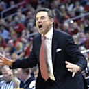 Louisville's head coach Rick Pitino shouts instructions to his team during the first half of an NCAA college basketball game Sunday Jan. 12, 2014, in Louisville, Ky. (AP Photo/Timothy D. Easley)