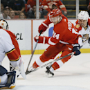Detroit Red Wings center Gustav Nyquist (14) attacks Florida Panthers goalie Roberto Luongo (1) as defenseman Willie Mitchell (33) defends in overtime of an NHL hockey game in Detroit, Friday, Dec. 12, 2014 The Associated Press
