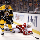 Boston Bruins defenseman Zdeno Chara (33) takes the puck away from fallen Detroit Red Wings' Justin Abdelkader during the first period Game 1 of a first-round NHL playoff hockey series in Boston, Friday, April 18, 2014 The Associated Press