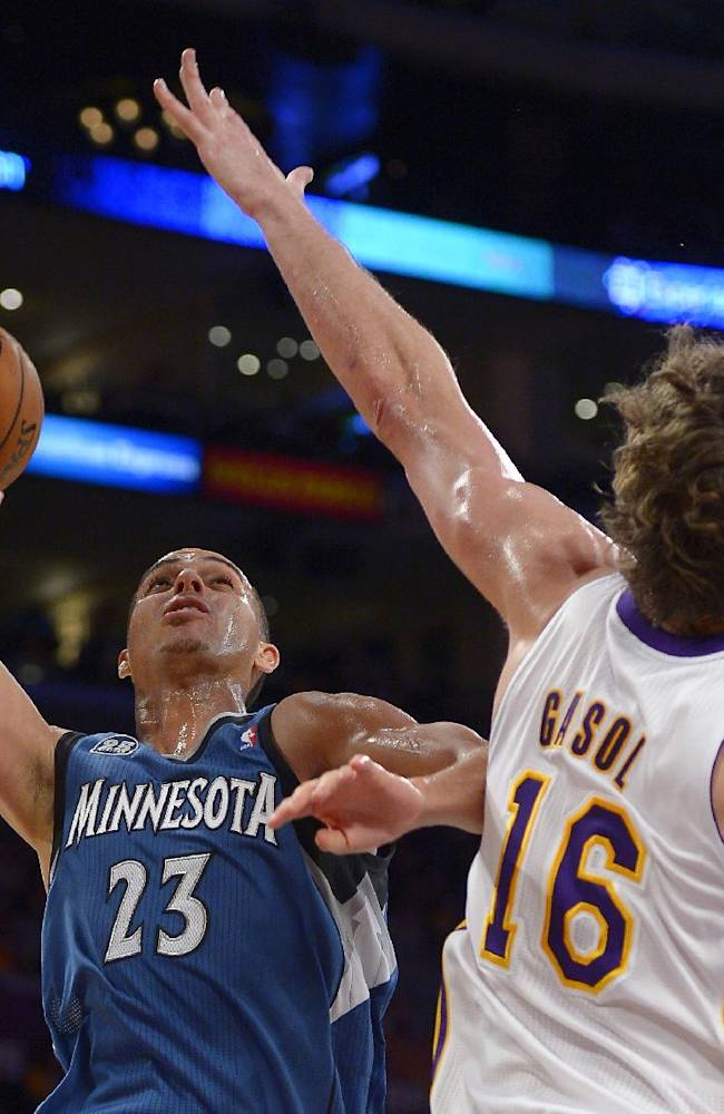 Minnesota Timberwolves guard Kevin Martin, left, puts up a shot as Los Angeles Lakers center Pau Gasol, of Spain, defends during the second half of an NBA basketball game, Sunday, Nov. 10, 2013, in Los Angeles