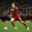Liverpool's Jordan Henderson runs with the ball during the Champions League Group B soccer match between Liverpool and FC Basel at Anfield Stadium in Liverpool, England, Tuesday, Dec. 9, 2014