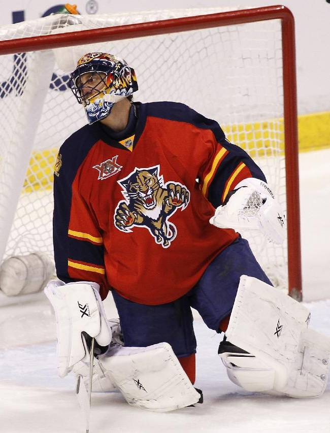 Florida Panthers goalie Roberto Luongo reacts after the Calgary Flames scored during the second period of an NHL hockey game in Sunrise, Fla., on Friday, April 4, 2014. Calgary won 2-1