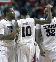 Temple's Khalif Wyatt, left, Ramone Moore (10) and Rahlir Hollis-Jefferson (32) celebrate after their overtime win against Massachusetts in an NCAA college basketball game on Wednesday, Feb. 29, 2012, in Philadelphia. Temple won 90-88. (AP Photo/H. Rumph Jr )