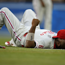 Philadelphia Phillies first baseman Ryan Howard rests on the field prior to a baseball game against the Los Angeles Dodgers, Monday, April 21, 2014, in Los Angeles The Associated Press