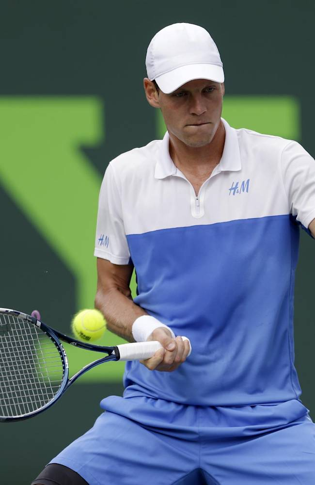 Tomas Berdych, of the Czech Republic, returns to Alexandr Dolgopolov, of Ukraine, at the Sony Open tennis tournament in Key Biscayne, Fla., Thursday, March 27, 2014