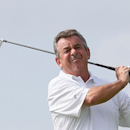 Tony Jacklin of England tees off on the first hole during the first round of the Mission Hills World Celebrity Pro-Am golf tournament in Haikou, China's Hainan province October 20, 2012. REUTERS/Tyrone Siu (CHINA - Tags: SPORT GOLF ENTERTAINMENT) - RTR39CO4