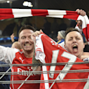 Arsenal fans celebrate their team's 2-1 win after the Group D Champions League match between Anderlecht and Arsenal at Constant Vanden Stock Stadium in Brussels, Belgium, Wednesday Oct. 22, 2014