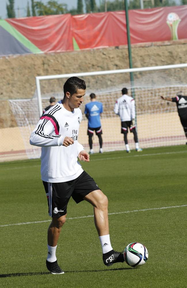 Real Madrid's Cristiano Ronaldo controls the ball during a training session at the Club World Cup soccer tournament in Marrakech, Morocco, Thursday, Dec. 18, 2014. Real Madrid will play against San Lorenzo during their final game in Marrakech on Tuesday, Dec. 20