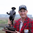 Jim Furyk holds the trophy after winning a playoff against Kevin Kisner during the RBC Heritage golf tournament in Hilton Head Island, S.C., Sunday, April 19, 2015. (AP Photo/Stephen B. Morton)