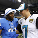 Detroit Lions running back Reggie Bush, left, talks with Jacksonville Jaguars quarterback Chad Henne (7) after a preseason NFL football game at Ford Field in Detroit, Friday, Aug. 22, 2014 The Associated Press