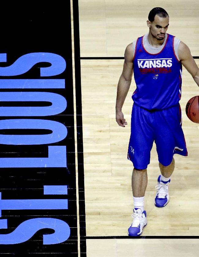 Kansas's Perry Ellis practices for the NCAA college basketball tournament Thursday, March 20, 2014, in St. Louis. Kansas is scheduled to play against Eastern Kentucky in a second-round game on Friday