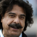 FILE - In this Sunday, Dec. 23, 2012 file photo, Jacksonville Jaguars owner Shad Khan talks with fans on the sidelines before the start of an NFL football game against the New England Patriots, in Jacksonville, Fla. Jacksonville Jaguars owner Shad Khan bought Premier League club Fulham on Friday, July 12, 2103, becoming the sixth American owner in England's top league. The deal between previous owner Mohamed Al Fayed and Khan for the sale of the London club was completed on Friday and approved by the Premier League. Financial details of the deal were not disclosed. (AP Photo/Stephen Morton, File)