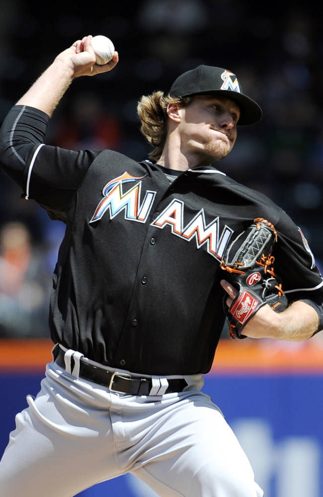Miami Marlins starting pitcher Tom Koehler throws against the New York Mets in the first inning of a baseball game at Citi Field on Sunday, April 27, 2014, in New York
