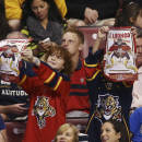 Two young Florida Panthers fans welcome Roberto Luongo back to the team during the first period of an NHL hockey game against the Boston Bruins in Sunrise, Fla., Sunday, March 9, 2014. (AP Photo/J Pat Carter)