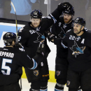 San Jose Sharks' Dan Boyle (22), celebrates his goal against the Winnipeg Jets with teammates Martin Havlat (9), Matt Irwin (52) and James Sheppard (15) during the first period of an NHL hockey game on Thursday, March 27, 2014, in San Jose, Calif The Ass