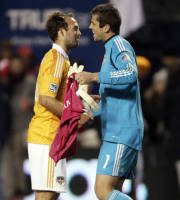 Houston Dynamo midfielder Adam Moffat (16), left, celebrates with goalie Tally Hall (1) after they defeated the Chicago Fire 2-1 in an MLS soccer playoff match, Wednesday, Oct. 31, 2012, in Bridgeview, Ill. (AP Photo/Nam Y. Huh)