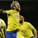 Derby's Johnny Russell celebrates scoring a goal during the English League Cup soccer match between Fulham and Derby County at Craven Cottage stadium in London, Tuesday, Oct. 28, 2014