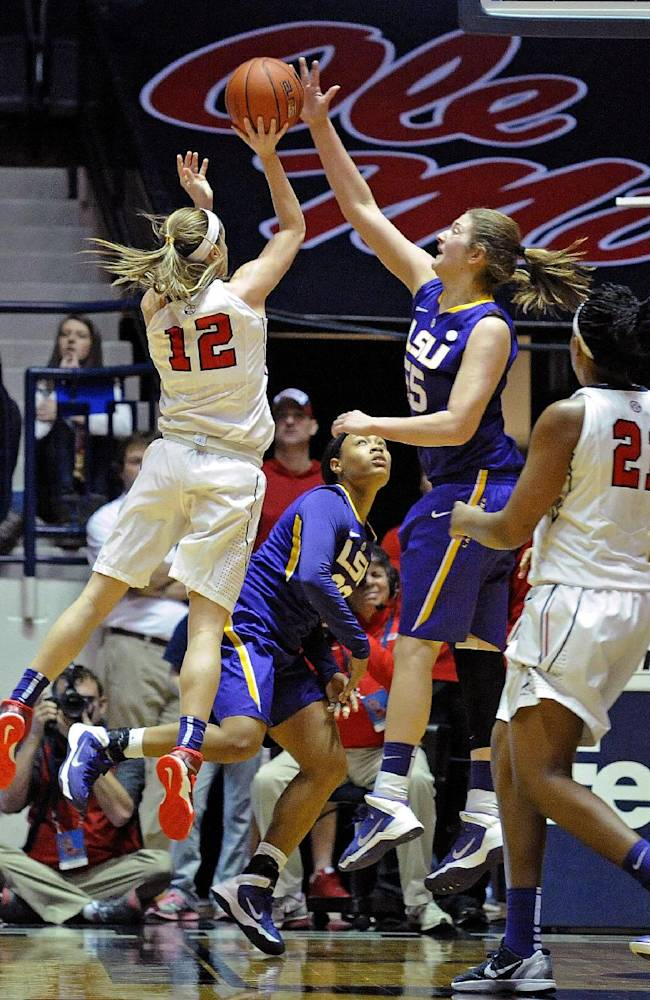 LSU forward Theresa Plaisance (55) blocks a shot by Mississippi guard Gracie Frizzell (12) during the second half of an NCAA college basketball game in Oxford, Miss., Sunday, Jan. 26, 2014. LSU won 66-56