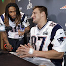 New England Patriots tight end Rob Gronkowski (87) is questioned about his favorite music by running back Brandon Bolden (38) during a news conference Thursday, Jan. 29, 2015, in Chandler, Ariz. The Patriots play the Seattle Seahawks in NFL football Super