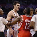 Officials Tom Washington (49) and Haywoode Workman (66) move in to separate Oklahoma City Thunder center Steven Adams (12) and Houston Rockets guard James Harden (13) during the third quarter of an NBA basketball game in Oklahoma City, Tuesday, March 11,