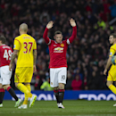 Wayne Rooney, centre, celebrates after scoring during the English Premier League soccer match between Manchester United and Liverpool at Old Trafford Stadium, Manchester, England, Sunday, Dec. 14, 2014